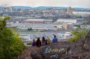 A group of students view Knoxville from the Bluffs in South Knoxville